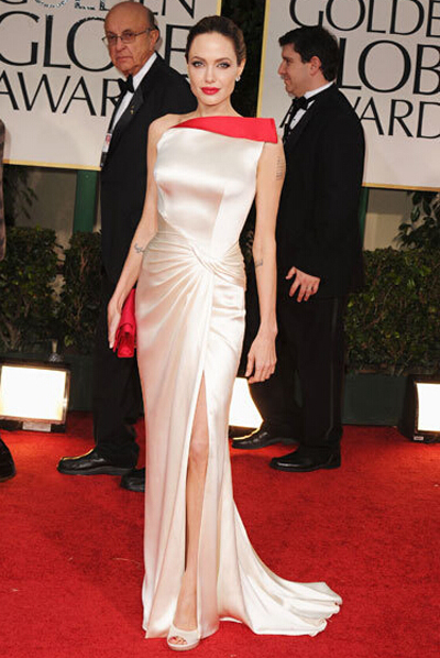 Angelina Jolie's white long dress with red handbag