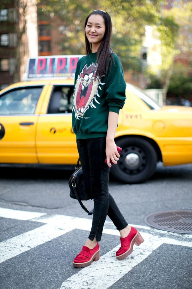 Chinese supermodel Liu Wen's cartoon green sweater