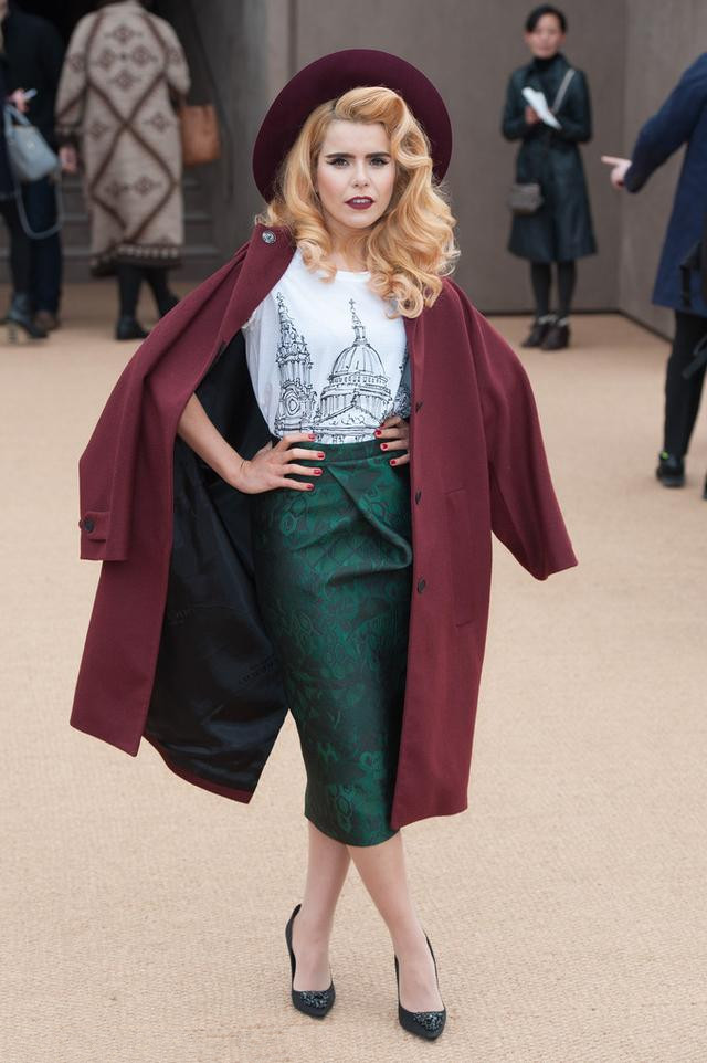 Paloma - Faith wearing red hat and coat with dark green satin pencil skirt