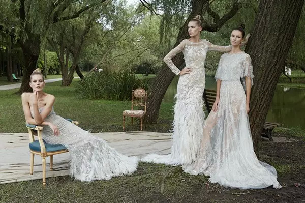 Three brides who wear lace wedding dress under the tree