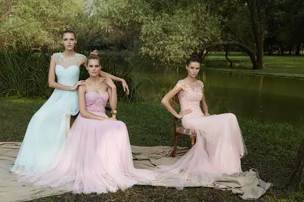 three brides who wear colored wedding dress under the tree
