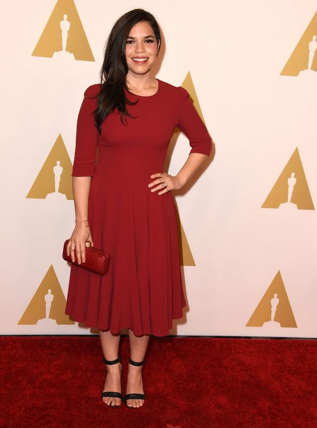 America Ferrera's wine red knee length evening dress